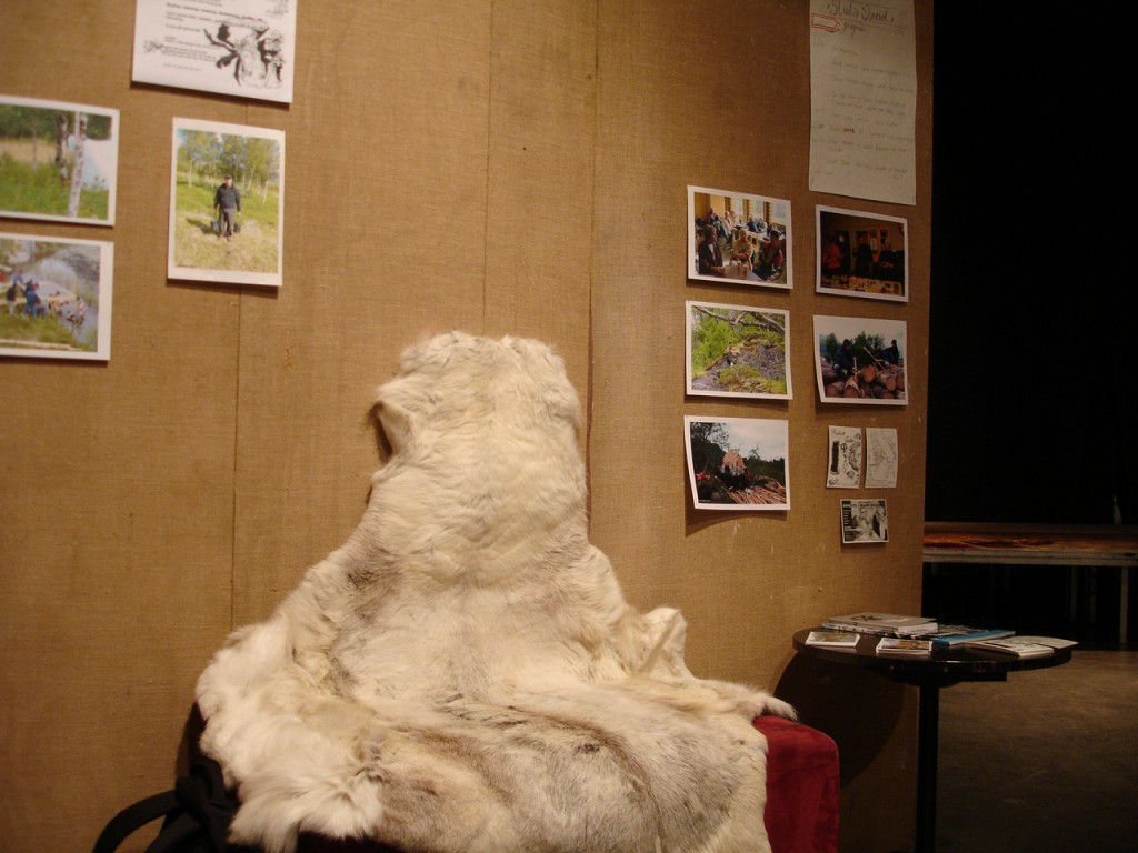 Studio view displaying images and posters from Sørfinnset skole/the nord land, at the Studio Stand (2007).  Photo: Rakett